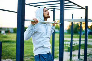 Young man training on sport equipment outside