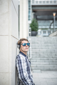 young model hansome blonde man in the city