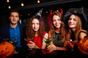 Young people drinking martini at Halloween eve