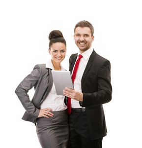 Young smiling business woman and business man isolated over white background with digital tablet