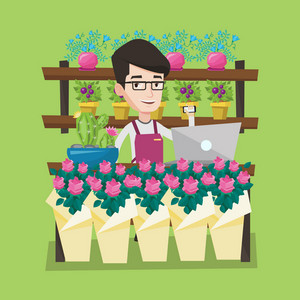 Young smiling florist using telephone and laptop to take order. Friendly florist standing behind the counter at flower shop. Man working in flower shop. Vector flat design illustration. Square layout.