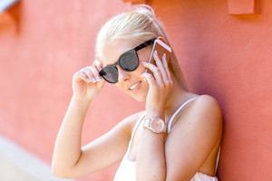 Young smiling woman talking in the phone outdoor