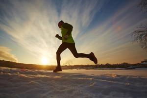Young sportsman running in snow