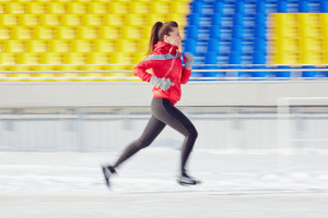 Young sporty woman running at stadium