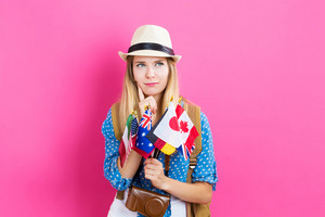 Young traveling woman deciding where to travel next