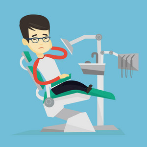 Young upset asian patient visiting dentist because of toothache. Sad patient suffering from toothache. Sorrowful man having a strong toothache. Vector flat design illustration. Square layout.
