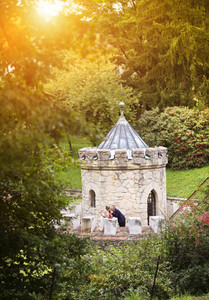 Young wedding couple enjoying romantic moments in front of a castle