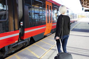 Young woman at a outdoor train terminal
