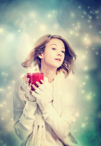 Young woman holding a red coffee mug