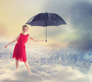 Young woman in Red Dress Shielding the City from the Weather