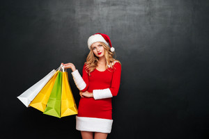 young woman in santa claus costume