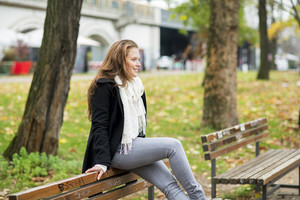 Young woman is taking rest in the city park
