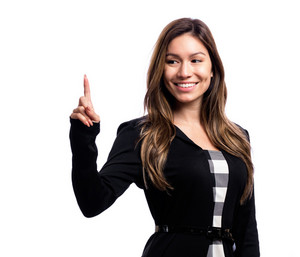 Young woman pointing something on a white background