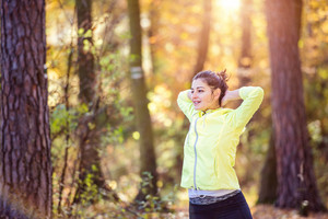 Young woman running outside in sunny nature