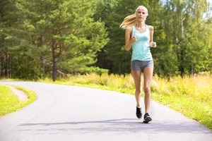 Young woman runs alone outdoor in the forest