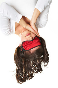 Young woman sleeping upside down