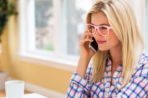 Young woman talking on the phone in an office