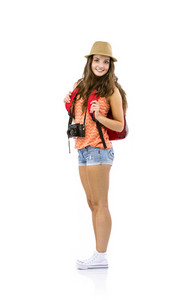 Young woman tourist with camera and backpack, isolated on white