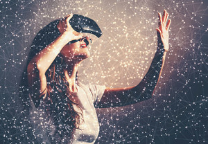 Young woman using a virtual reality headset with conceptual network lines