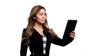 Young woman using her tablet on a white background