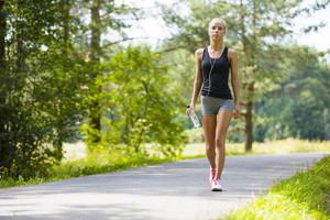 Young woman walks outdoor as workout
