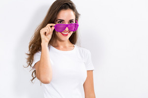 Young woman wearing shutter shades sunglasses on a white background