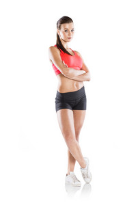 Young woman with beautiful slim body in sport clothes.