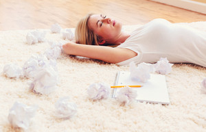 Young woman with crumpled paper creativity concept