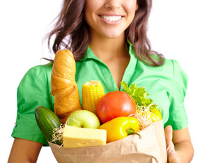 Young woman with sack of healthy products