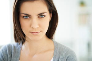 Young woman with serious expression looking at camera