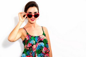 Young woman with sunglasses on a white background