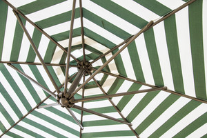 Green and white umbrella beach