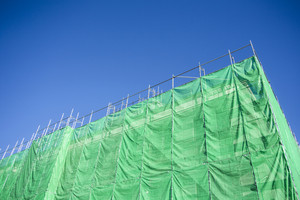 Green cloth cover on building construction site