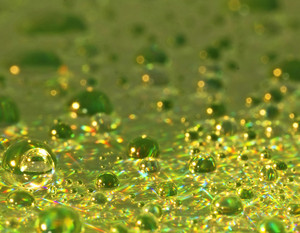 Green Shiny Drops Background