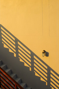 grey step on original yellow wall