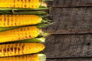 Grilled Corn On Wooden Table