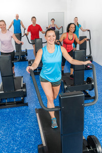 Group gym class walk treadmill running belt at fitness club