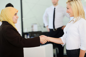 Group of Arabic business people handshaking for a deal