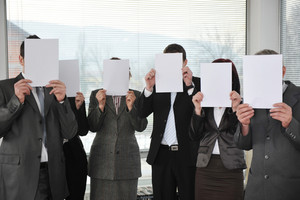 group of business people holding blank signs