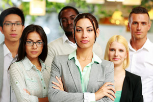 Group of co-workers standing in office