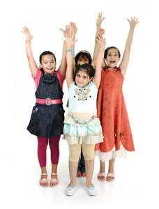 Group of four girls together on white background, rising hands up