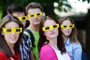 Group of friends in the park with 3d cinema glasses