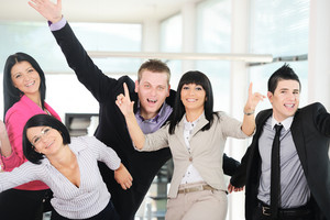 Group of happy cheerful casual businesspeople smiling together and having fun