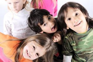 Group of happy playful children in studio
