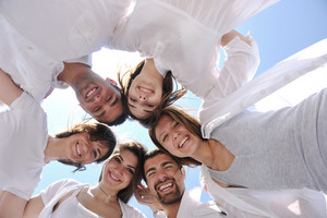 Group Of Happy Young People In Circle At Beach