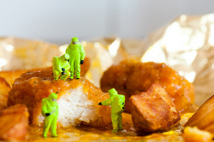 Group Of Scientists Inspecting Fried Chicken Nuggets