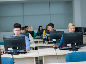Group of students in computer lab classroom