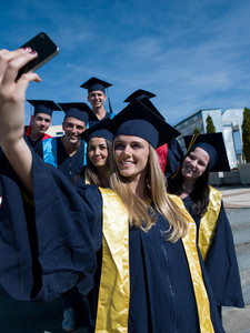 Group of students in graduates making selfie