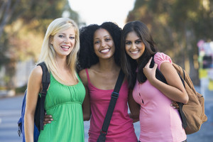 Group of three female friends having fun off campus