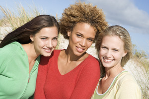 Group of three female friends outdoors at beach